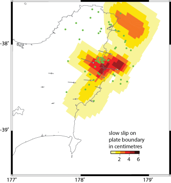 This map shows the amount of movement between the plates on the Hikurangi subduction zone over the last 1-2 weeks. The hot colors show movement in centimetres (see scale).  The earthquakes over the last 3 weeks (green dots) form a cluster in the area of the ongoing slow slip event.