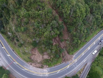 Photo from the drone taken on Saturday morning showing the extent of the first landslides. The landslide to the left came down early on Saturday, and had already been partially cleared by contractors. The one to the right came down while the contractors were working (Photo: GNS Science).
