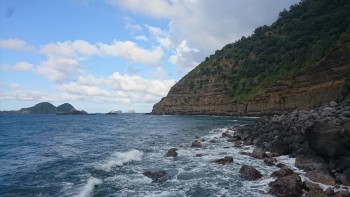Cliffs that surround Fishing Rock at Raoul Island.