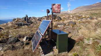 View of the Te Maari outstation showing the solar array, cabinet, web camera, telemetry antenna and GNSS pilar