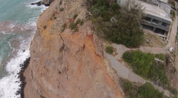 Drone photo of Whitewash Head showing new cracks in the cliff face - the rest of the road on the right fell into the sea during the 13 June 2011 earthquake