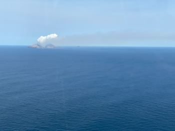 The vivid white steam and gas plume above the volcano